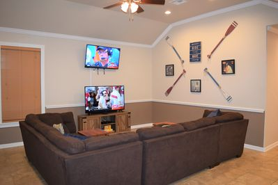 Living room with two working televisions--perfect for football season.