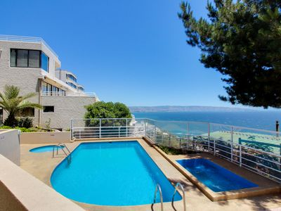 Photo for Oceanfront views, a shared pool & hot tub, a fitness gym & more!