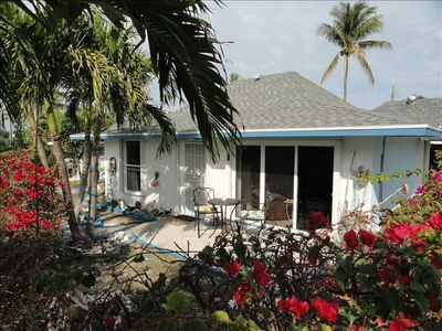 Photo for $125/night + cleaning; villa wifi-Free US calls-TV-2BR/2B steps to beach