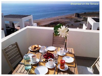 Photo for Elegant seafront apartment with great sea views and terrace in Playa Macenas.