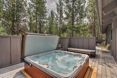 With 4 bedrooms, 2.5 bathrooms, a private hot tub & deck, this home has it all.