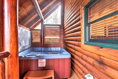 Relax and unwind in the vacation rental's private hot tub.