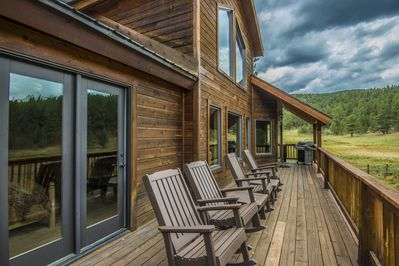 Back deck with rocking chairs and gas grill