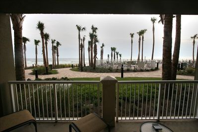 Patio overlooking beach and pool area