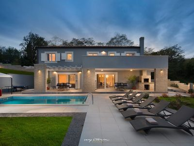 Photo for Modern villa with pool surrounded by nature