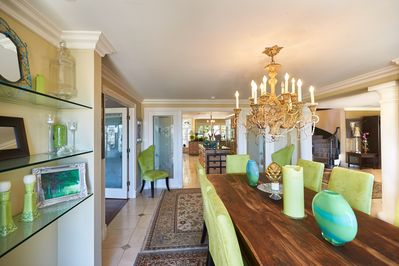 Formal Dining room seats 12 opens to open-air whitewater  views and verandas