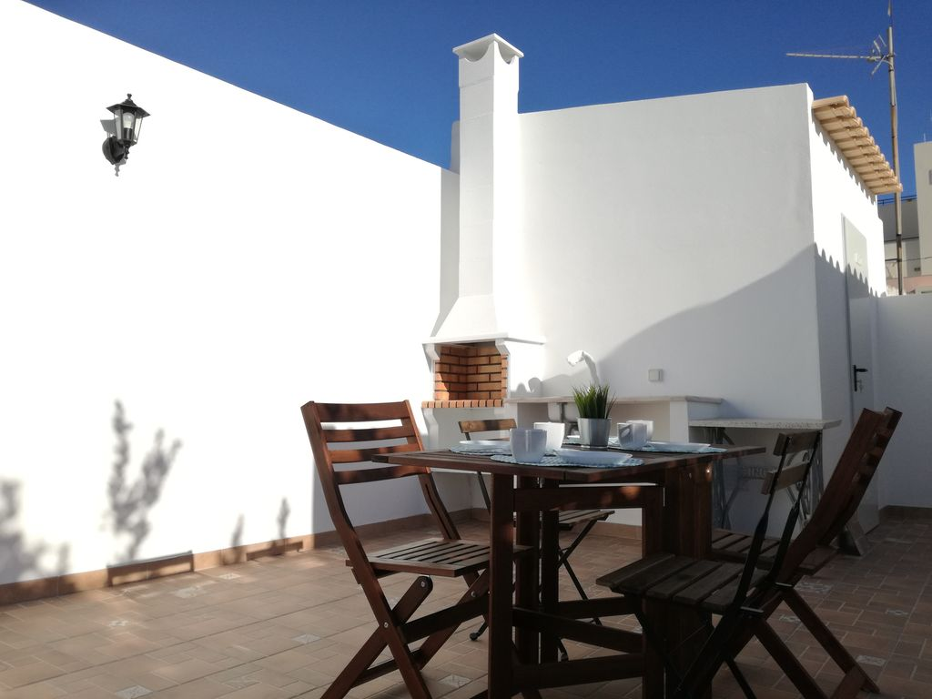 A typical Faro house with a sunny terrace  and barbecue in center of the city