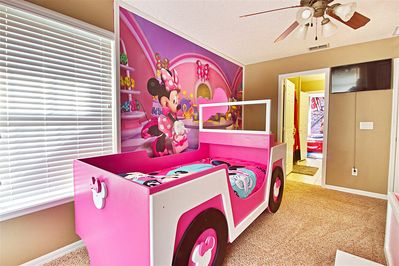 Minnie jeep themed custom built twin beds with Minnie bow and Minnie hub caps