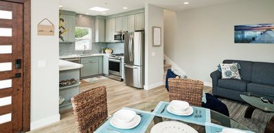 Open floor plan with a full size new kitchen, queen-size pull out couch, patio.