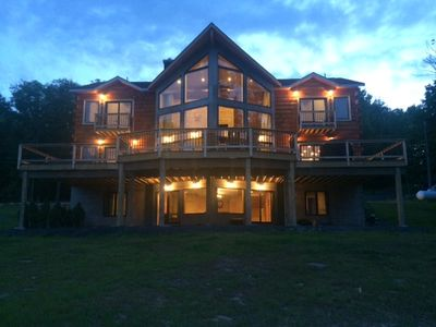 Photo for Luxurious Lakefront Home With Mtn Views, Beach,Steps To Town & Ski