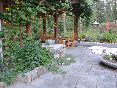 Photo for Artisan cottage with lily pond, cabana, patio dining. Surrounded by Nature.