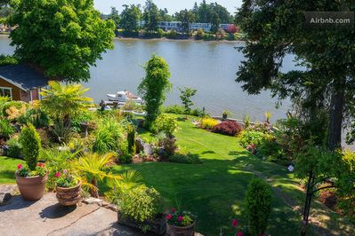 Victoria Oceanfront -   A view of the gardens and inlet as seen from upper patio