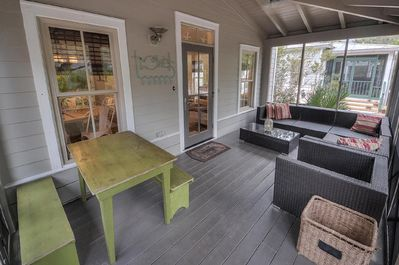 Screened porch in front of house.