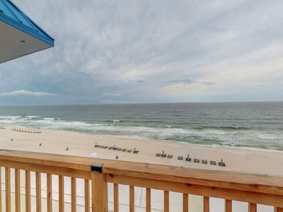 Photo for Beachfront condo with resort pool and private rooftop deck