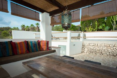 Moroccan style outdoor seating area by the pool