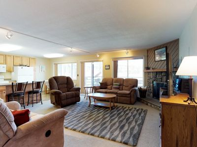 Photo for NEW LISTING! Mountain view condo w/shared pool/hot tub/game room - on bus route