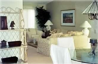 Living room and partial dining area.