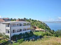 Roomy, quiet and reasonably well equipped apartment with a great view to the sea from the terrac...