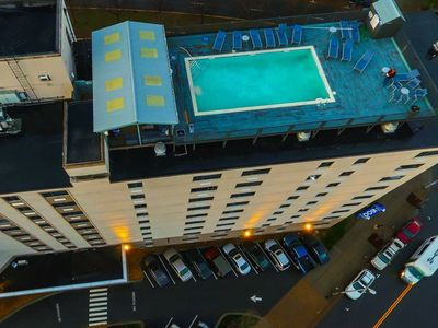 Photo for roof top pool and great view of the city!!!!! 4 queen beds