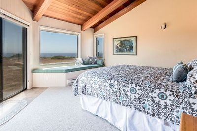 Master suite with door out to oceanside deck.