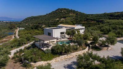 Photo for Stunning villa and swimming pool in private olive grove with panoramic sea views