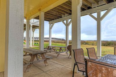 Plenty of room to cook out and entertain!  Crossover to beach 2 houses away!