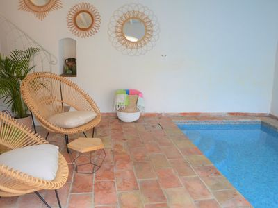 Photo for One minute walk from the port,  Private heated pool and car park