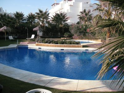 Photo for Large, beautifully furnished apartment with huge terrace, garden and sea views