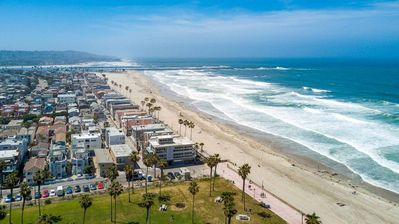 A grass park and miles of sandy beaches are at your doorstep
