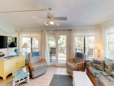 Photo for NEW LISTING! Waterfront getaway w/two shared pools, hot tub, gym & beach access