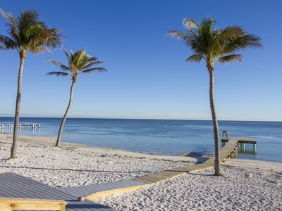 Photo for Oceanfront duplex with beautiful beach and dock for boat access! Dogs OK!