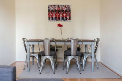 The dining area has a modern, yet retro feel
