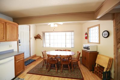 Kitchen nook with dining room table, seats 6.