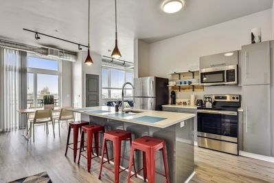 Open Kitchen with Island Seating and Stainless Appliances