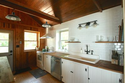 Fully equipped kitchen. This 1948 cottage is a lovely mix of vintage and modern.