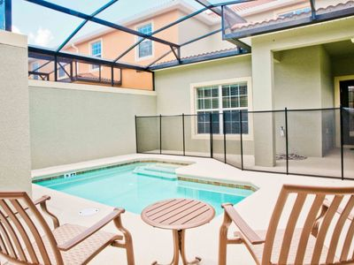 Photo for Fabulous 5 Bedroom Townhome with private pool and free wifi