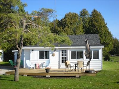 Photo for Lovely little cottage directly across from the warm beach and park on Lake Huron