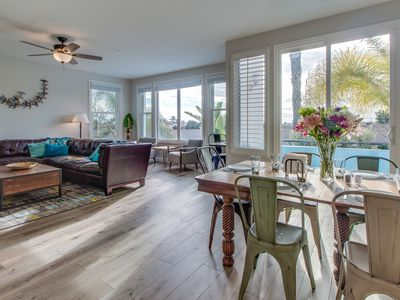 Photo for Sleekly styled condo with oceanview rooftop patio, short drive to beach!