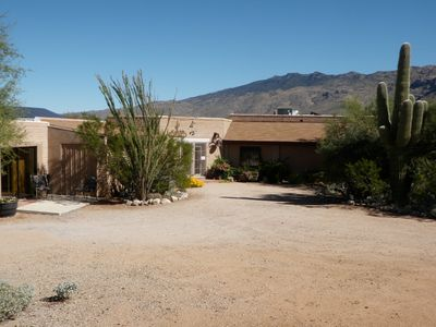 Guest House entry and parking with mountain views of Saguaro National Park East.