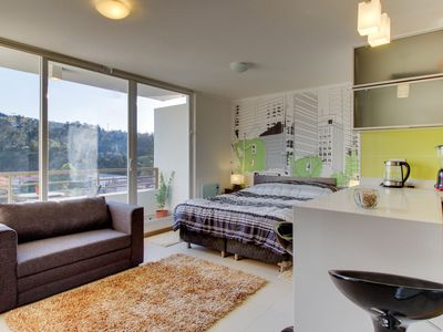 Cozy studio condo with great views from private balcony w/shared BBQ area