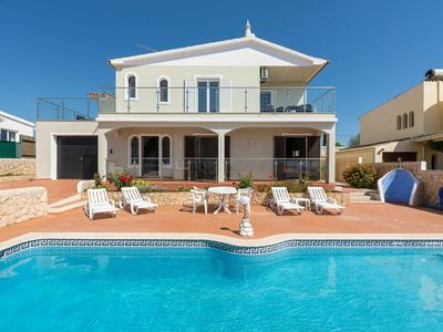 Photo for Spacious modern Villa with pool in quiet residential area near Guia