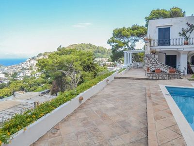 Photo for 7 bedroom Villa, sleeps 13 with Pool, Air Con, FREE WiFi and Walk to Shops