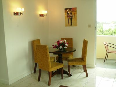Dining Area leading to balcony with seating for 4