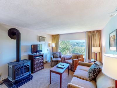 Photo for NEW LISTING! Beautiful condo w/ forest views, gas fireplace, and shared pool!