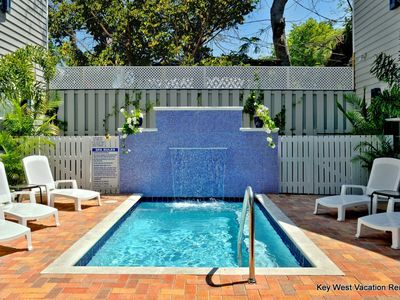Photo for Cute dog-friendly tropical condo close to attractions w/a pristine shared pool
