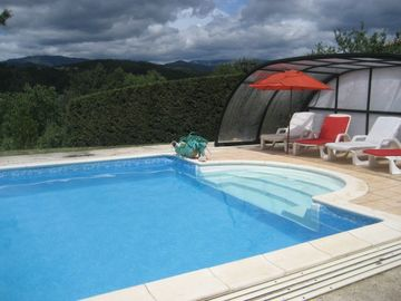 Luxurious, well appointed flat for 4 with solar heated pool, garden, sauna, view