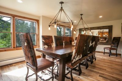 Spacious and classy dining room with seating for 10-12. A wonderful atmosphere for dining in or entertaining.