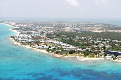 View of Seven Mile Beach. The condo is located in the red roof complex