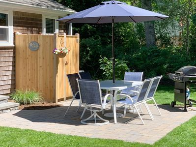 Back patio with a gas grill and an enclosed outdoor shower - 37 Jacqueline Circle West Yarmouth Cape Cod New England Vacation Rentals
