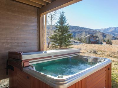Photo for Rustic home w/ private hot tub; mountain views & fireplace